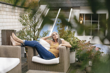 Woman relaxing on terrace - KNSF03528