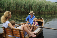 Family in rowing boat on lake - ECPF00160