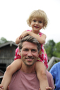 Portrait of happy man carrying his little daughter on shoulders - ECPF00175