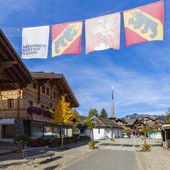 Switzerland, Canton of Bern, Gstaad, pedestrian area and chapel - WDF04297