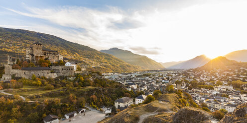Switzerland, Canton Vaud, Sion, townscape with Notre-Dame de Valere at sunset - WDF04309
