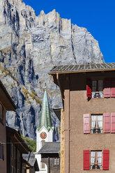 Switzerland, Valais, Leukerbad, church, house and mountain massif Leeshoerner - WDF04315