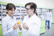 Pharmacist advising customer in pharmacy - WESTF23910