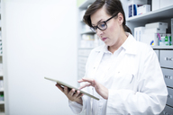Pharmacist using tablet in pharmacy - WESTF23922