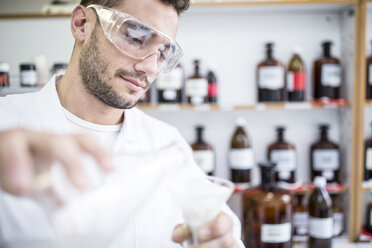 Man working in laboratory of a pharmacy - WESTF24006