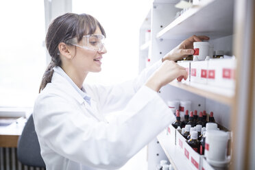 Woman working in laboratory of a pharmacy - WESTF24012