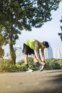 Runner warming up in urban park - SBOF01118
