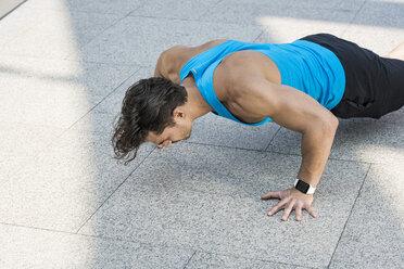 Athlete exercising push-ups in the city - SBOF01124
