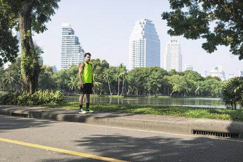 Runner training on street in urban park - SBOF01139
