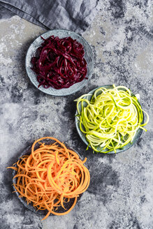 Bowl of Zoodles and bowls of carrot  and beetroot spaghetti - SARF03469