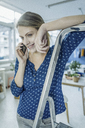 Portrait of smiling young woman on the phone - JOSF02138