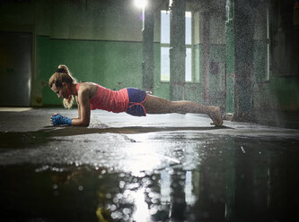 Woman having a workout in a hall - CVF00001