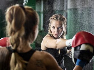 Two women having martial arts training - CVF00004