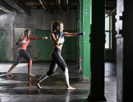 Two women having martial arts training - CVF00010