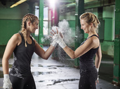 Two female martial arts shaking hands after training - CVF00013