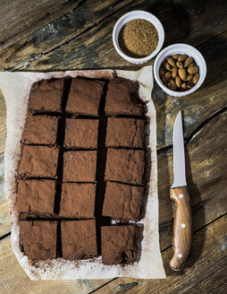 Homemade brownies on parchment paper - GIOF03748