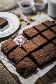 Homemade brownies on parchment paper - GIOF03751