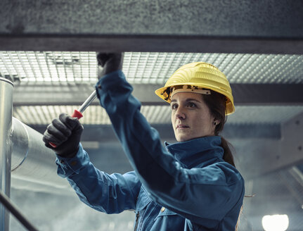 Craftswoman wearing hard hat at work - CVF00028