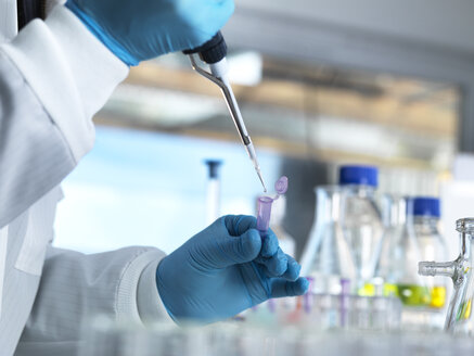 Scientist pipetting a DNA sample into a eppendorf tube for genetic testing in a laboratory - ABRF00013