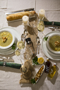 Garlic cream soup with croutons on festive laid table - MAEF12482
