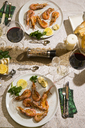 Argentine red shrimps on festive laid table - MAEF12488