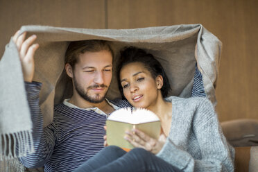 Portrait of young couple relaxing together at home - FMKF04723