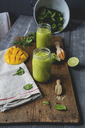 Glasses of spinach smoothie with mango, lime juice and hemp seed - ODF01582