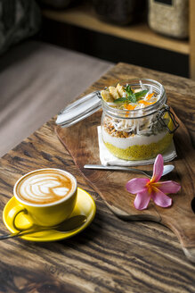 Exotic muesli with flower and coffee cup on a wooden table - SBOF01201