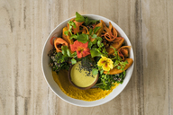 Decorated salad with pumpkin, hummus, broccoli and edible flower - SBOF01225