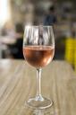 Glass of rose wine on wooden tale - SBOF01240