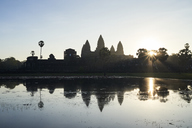 Cambodia, Siem Riep, silhouette of Angkor Wat at sunrise - IGGF00397