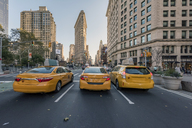 USA, New York City, Manhattan, taxis on the street at night - RPSF00170