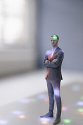Miniature businessman figurine surrounded by points of light - FLAF00134
