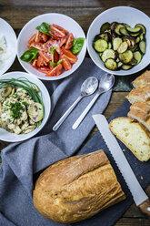 Bruschetta and various ingredients, bread, tomato, zucchini, walnuts, mushroom and herbs - GIOF03757