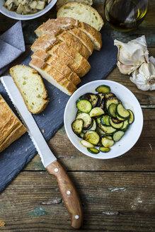 Bruschetta and various ingredients, bread, zucchini and garlic - GIOF03760