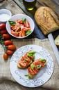 Bruschetta with tomato and basil - GIOF03766