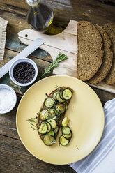Bruschetta and various ingredients, rye bread, zucchini, rosemary, garlic - GIOF03769