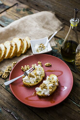Bruschetta and various ingredients, ricotta cheese, nuts, olive oil, bread - GIOF03772