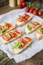 Bruschetta, bread, tomato and olive oil - GIOF03784