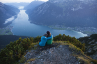 Austria, Tyrol, two hikers enjoying the view on Achensee - FAF00078