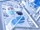 Technician working in lab wearing cleanroom overall - CVF00036