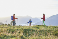 Austria, Tyrol, Mieming Plateau, hikers on alpine meadow - CVF00057