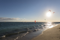 Mauritius, Southwest Coast, beach of Le Morne with kite surfers and sail boarders - FOF09756