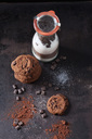 Chocolate cookies and glass bottle of baking mix - CSF28778