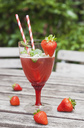 Strawberry lemonade in glass with drinking straws - GWF05387