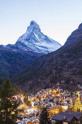 Switzerland, Valais, Zermatt, Matterhorn, townscape, chalets, holiday homes in the evening - WDF04331