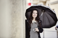 Portrait of fashionable young woman with black vintage umbrella - JATF00993
