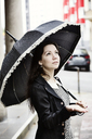 Portrait of fashionable young woman with black vintage umbrella - JATF00996