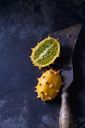 Sliced kiwano and cleaver on rusty metal - CSF28791