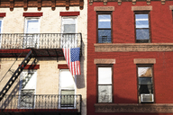USA, New York City, Brooklyn, residential house with American flag - CMF00776